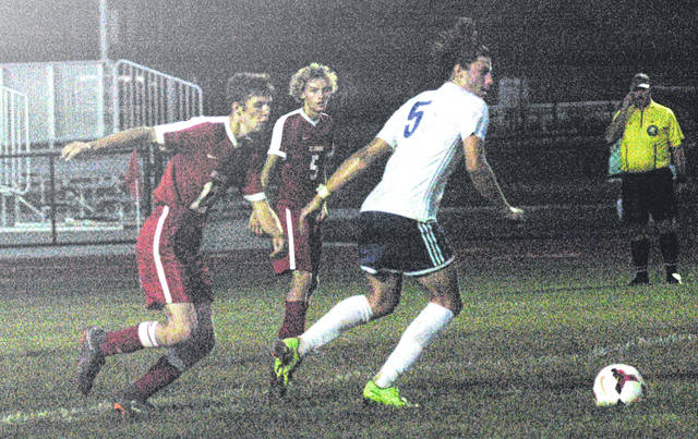 Hillsboro's Ethan Humphries (5) moves toward the ball on Thursday night at Hillsboro High School where the Indians took on the Cavaliers in boys soccer action. The Cavaliers won the match by a score of 6-0.