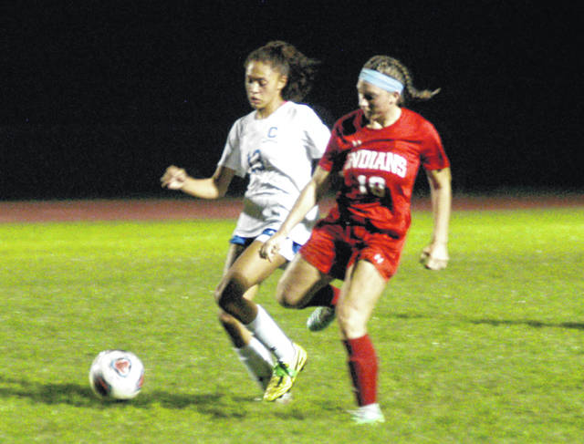 A Lady Indian soccer player tries to take the ball from Chillicothe's Allia Hoosier on Thursday at Hillsboro High School where the Lady Indians battled the Lady Cavaliers in Frontier Athletic Conference girls soccer action. The Lady Indians picked up the victory with a final score of 3-1