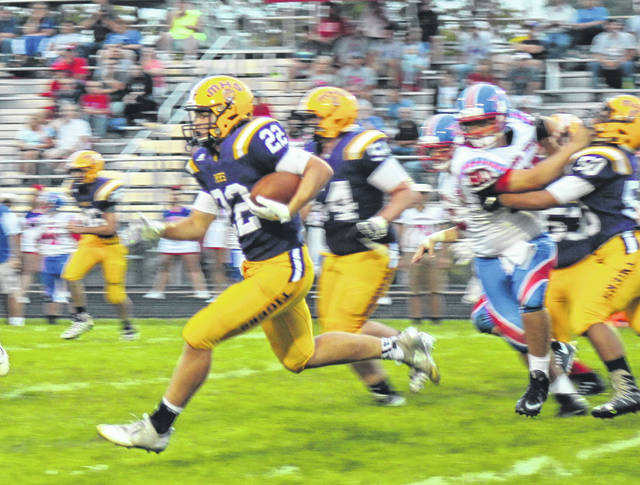 McClain's Dalton Mischal rushes against the Zane Trace Pioneers on Friday at McClain High School where the Tigers fell to the Pioneers 39-21.