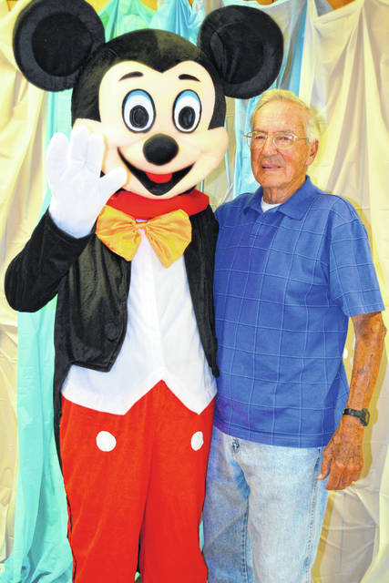 Bill Jones recently signed up for a lifetime membership at the Highland County Senior Citizens Center. Jones and Mickey Mouse both turn 90 this year.