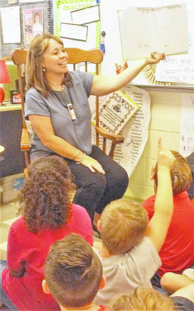 Shown is a typical morning in Cassie Adkins' class as she reads to her students at Hillsboro Elementary School.
