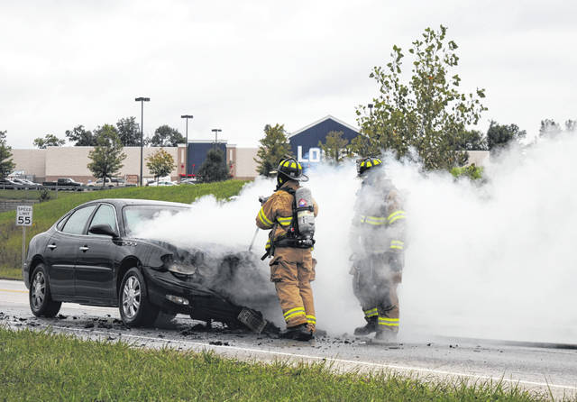 A car fire had traffic on SR 73 near Harry Sauner Road snarled around the evening rush hour Monday. No one was injured, but the car sustained severe damage. Donna Caraway of West Union said she was headed south on 73 after visiting her sister in Dayton when a nearby driver told her the bottom of her car was on fire. Hillsboro Police Officer Jeremy Conley said sheriff's deputies attempted to douse the blaze with fire extinguishers but couldn't get the hood open. Firefighters used bolt cutters to undo the latch and extinguished the fire.