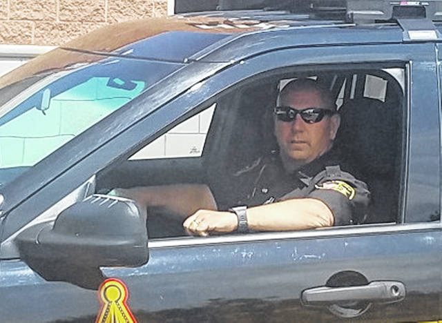 Sgt. Danny Croy is shown in his cruiser at the Highland County Justice Center in Hillsboro.